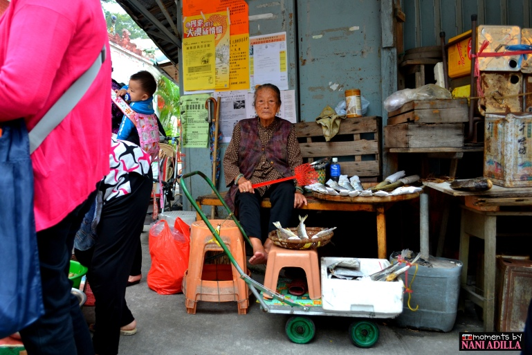 A lady looks on to sell her dried goods in Tai-O village